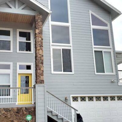 Grey house against a lake